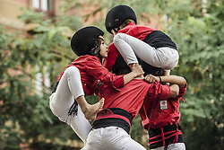 November 20, 2016 - Barcelona, Catalonia, Spain - A young member of the 'Castellers de Barcelona' climbs to the top of a human tower during a 'diada castellera' at Barcelona's Gracia quarter (Credit Image: © Matthias Oesterle via ZUMA Wire)