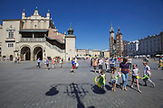 Poland, Krakow. Rynek Glówny (Market Square). Cloth Hall (l.) and St. Mary's Church.
