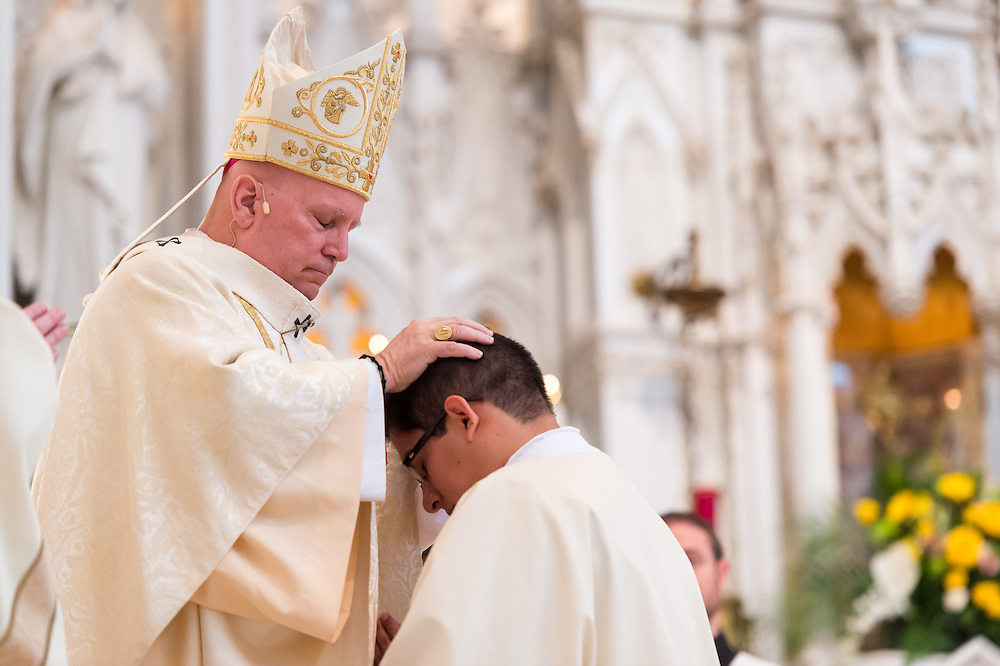 DENVER, CO - MAY 16: Denver Archbishop Samuel Aquila (L) lays hands on the Rev. Erik Vigil Reyes (R) during an ordination for priests in the Archdiocese of Denver at the Cathedral Basilica of the Immaculate Conception on May 16, 2015, in Denver, Colorado. (Photo by Daniel Petty/Denver Catholic Register)