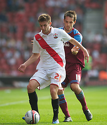 SOUTHAMPTON, WALES - Saturday, October 9, 2010: Tranmere Rovers' Maximo Blanchard and Southampton's Adam Lallana during the Football League One match at the St Mary's Stadium. (Pic by David Rawcliffe/Propaganda)