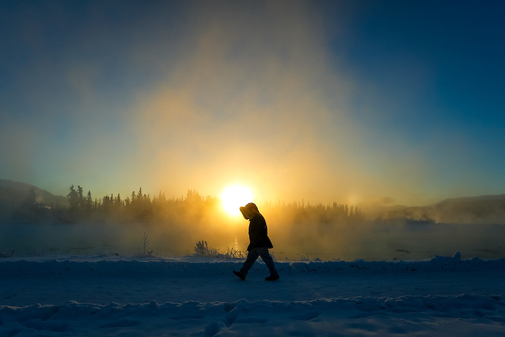 The sun peeks through the ice fog over the Yukon River in downtown Whitehorse.