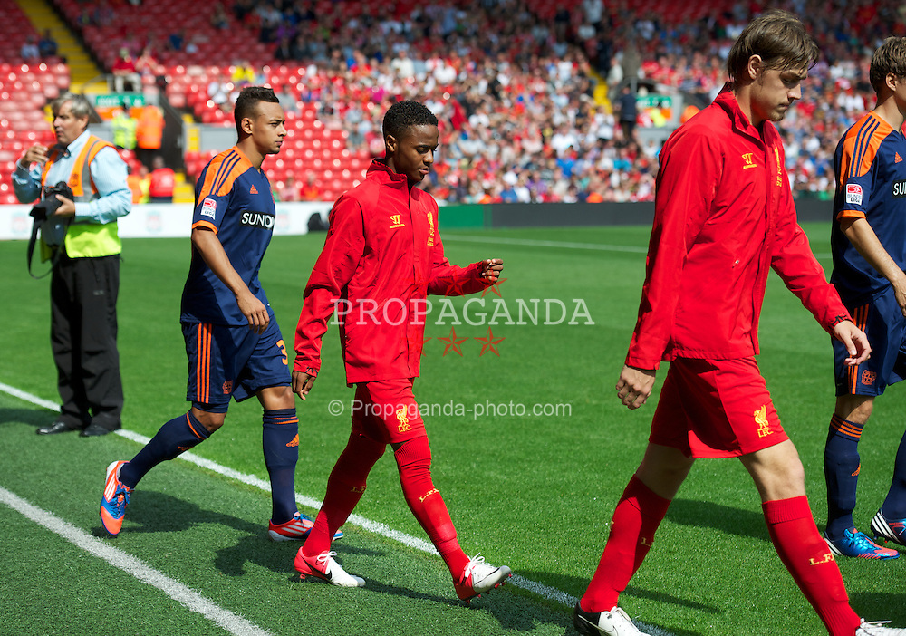LIVERPOOL, ENGLAND - Sunday, August 12, 2012: Liverpool's Raheem Sterling walks out to make his first competitive start against Bayer 04 Leverkusen during a preseason friendly match at Anfield. (Pic by David Rawcliffe/Propaganda)