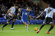Peterborough United forward Conor Washington strikes the ball during the Sky Bet League 1 match between Peterborough United and Shrewsbury Town at the ABAX Stadium, Peterborough, England on 12 December 2015. Photo by Aaron Lupton.