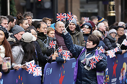 © Licensed to London News Pictures. 01/01/2019. London, UK. Members of the public await the start of the London New Year's Day Parade. More than 8,000 performers from 26 countries are taking part in the parade. Photo credit: Rob Pinney/LNP