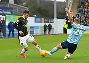 Graham Carey (10) of Plymouth Argyle is challenged by Nick Anderton (24) of Accrington Stanley during the EFL Sky Bet League 1 match between Plymouth Argyle and Accrington Stanley at Home Park, Plymouth, England on 22 December 2018.