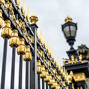 Gold decorated gates in front of the Royal Palace of Brussels, the official palace of the Belgian royal family.