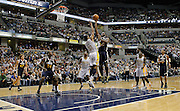February 25, 2011: Utah Jazz center Al Jefferson (25) shoot a floater over Indiana Pacers small forward Danny Granger (33) during an NBA basketball game between the Utah Jazz and Indiana Pacers at Conseco Fieldhouse in Indianapolis, Indiana. Utah defeated Indiana 95-84.