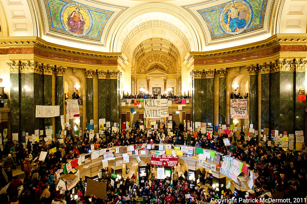 An estimated 70 to 100 thousand demonstrators converged on the state capitol building in Madison, Wisc. on February 26 2011 for the 13th straight day to protest the Budget Repair bill proposed by Wisconsin's new Republican Governor Scott Walker. The bill, if passed, would restrict collective bargaining for most government workers.
