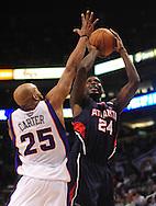 Feb. 23, 2011; Phoenix, AZ, USA; Atlanta Hawks forward Marvin Williams (24) puts up a shot against the Phoenix Suns guard Vince Carter (25) at the US Airways Center. Mandatory Credit: Jennifer Stewart-US PRESSWIRE