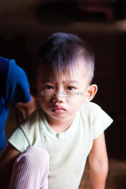 Young boy in Nanga Sumpa Longhouse, Sarawak.