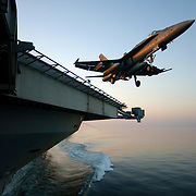 "An F/A-18A Hornet assigned to the ""Silver Eagles"" of Marine Strike Fighter Squadron (VMFA) 115 clears the flight deck after launching from the Nimitz-class aircraft carrier USS Harry S. Truman (CVN 75)."
