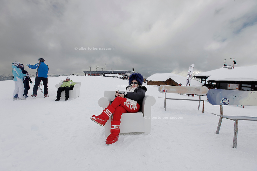 Italy, Madonna di Campiglio, waiting for the sun outside Chalet FIAT