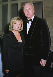 Singer ELAINE PAIGE and MR CHRISTOPHER LAWRENCE-PRICE, at a dinner in London on 16th January 1999.MNF 13