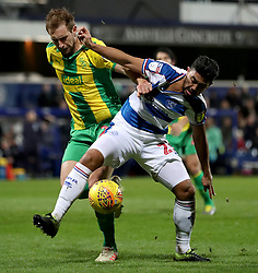 Queens Park Rangers' Massimo Luongo (right) is taken down inside the box by West Bromwich Albion's Craig Dawson during the Sky Bet Championship match at Loftus Road, London.