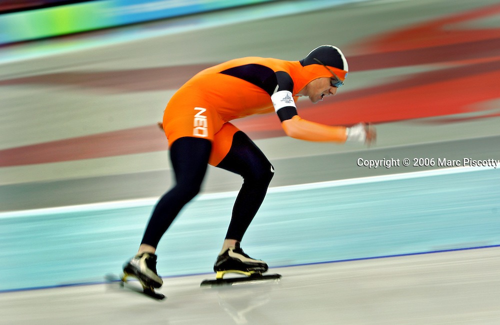 Bob de Jong of the Netherlands rounds a corner on his way to a gold medal during the Men's 10,000 Meter Speed Skating event at the Oval Lingotto in Turin, Italy on Friday February 24, 2006. Bob de Jong of the Netherlands won the event with a time of 13:01.57 while U.S. speed skater Chad Hedrick took the silver with a time of 13:05.40 and Carl Verheijenof alsoo of the Netherlands took the bronze with a time of 13:08.80..(Photo by Marc Piscotty / © 2006)