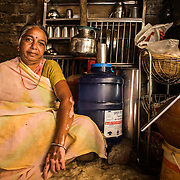 CAPTION: Bagwant Bai with her RO watercan. LOCATION: Rahul Gandhi Nagar, Indore, Madhya Pradesh, India. INDIVIDUAL(S) PHOTOGRAPHED: Bhagwant Bai.