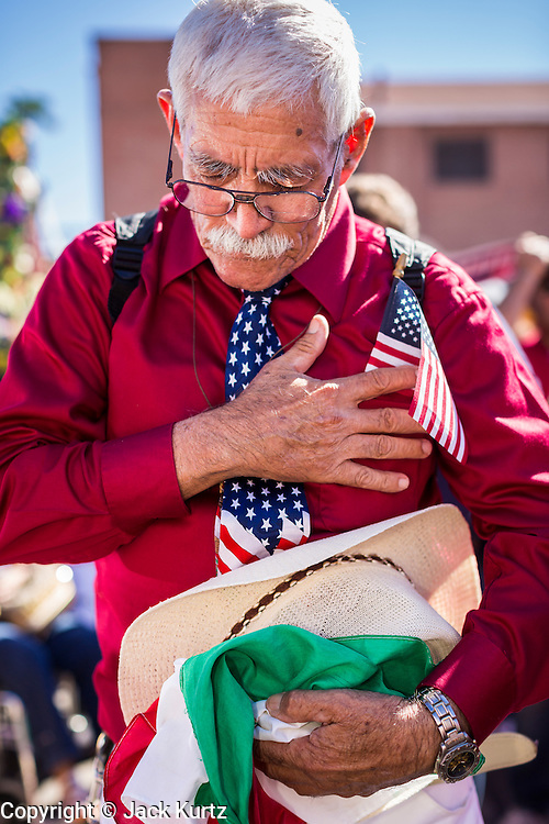 05 OCTOBER 2013 - PHOENIX, ARIZONA: A man prays during an immigration reform rally in Phoenix. More than 1,000 people marched through downtown Phoenix Saturday to demonstrate for the DREAM Act and immigration reform. It was a part of the National Day of Dignity and Respect organized by the Action Network.   PHOTO BY JACK KURTZ