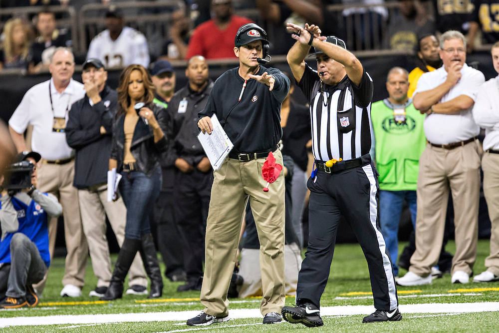 NEW ORLEANS, LA - NOVEMBER 17: Head Coach Jim Harbaugh of the San Francisco 49ers throws his red flag during a game against the New Orleans Saints at Mercedes-Benz Superdome on November 17, 2013 in New Orleans, Louisiana.  The Saints defeated the 49ers 23-20.  (Photo by Wesley Hitt/Getty Images) *** Local Caption *** Jim Harbaugh