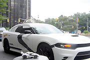 A Star Wars First Order Stormtrooper Dodge vehicle, modeled after the new Hot Wheels line of Star Wars character cars, waits to pick up Uber riders in New York's Columbus Circle, Friday, Sept. 4, 2015, to celebrate Force Friday. (Photo by Diane Bondareff/Invision for Mattel/AP Images)