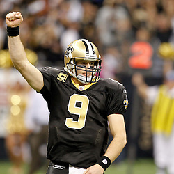 December 26, 2011; New Orleans, LA, USA; New Orleans Saints quarterback Drew Brees (9) celebrates after Brees breaking the NFL single-season passing record formerly held by Miami Dolphins quarterback Dan Marino on a 9-yard touchdown throw to Darren Sproles during a game against the Atlanta Falcons at the Mercedes-Benz Superdome. The Saints defeated the Falcons 45-16.  Mandatory Credit: Derick E. Hingle-US PRESSWIRE