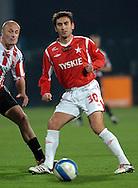 n/z.: Jacek Wisniewski (nr3-Cracovia), Stanko Svitlica (nr30-Wisla) podczas meczu ligowego Wisla Krakow (czerwone) - Cracovia Krakow (bialo-czerwone) 3:0 ; I liga polska ; 12 kolejka sezon 2006/2007 , pilka nozna , Polska , Krakow , 28-10-2006 , fot.: Adam Nurkiewicz / mediasport..Jacek Wisniewski (nr3-Cracovia), Stanko Svitlica (nr30-Wisla) during Polish league first division soccer match in Cracow. October 28, 2006 ; Wisla Cracow (red) - Cracovia (white-red) 3:0 ; first division ; 12 round season 2006/2007 , football , Poland , Cracow ( Photo by Adam Nurkiewicz / mediasport )