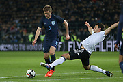 Eric Dier of England shoots at goal with a tackle from Mats Hummels of Germany during the International Friendly match between Germany and England at Signal Iduna Park, Dortmund, Germany on 22 March 2017. Photo by Phil Duncan.