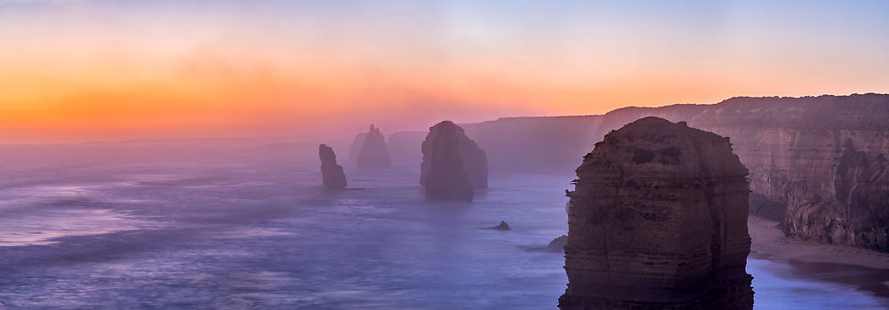 Evening twilight at the Twelve Apostles sea stacks on the Great Ocean Road, Victoria, Australia, after sunset with the western sky still colourful with twilight. <br /> <br /> This is a panorama of 4 segments with the 85mm Rokinon lens and Canon 6D. Stitched with PTGui.