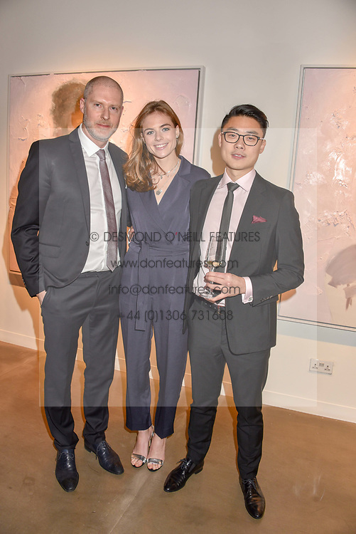 12 December 2019 - Jean-David Malat, Rosie Tapner and Henrik Uldalen at a private view of Lethe by Henrik Uldalen at JD Malat Gallery. 30 Davies Street, London.<br /> <br /> Photo by Dominic O'Neill/Desmond O'Neill Features Ltd.  +44(0)1306 731608  www.donfeatures.com