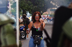 "An anti-government demonstrator taunts members of the National Guard  after an  opposition march  to demand that President Chavez  submit to a recall referendum turned violent.  She screamed at them: ""Here I am so you can kill me!"".  The march was held on the first day of the G15 summit in Caracas."