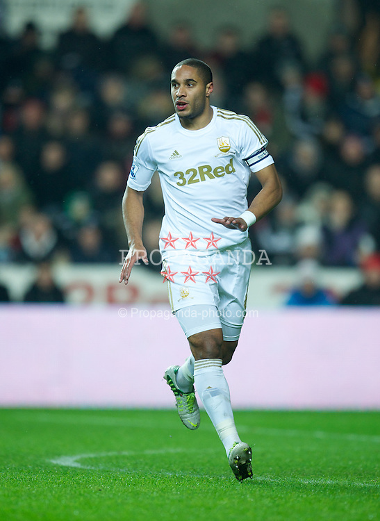 SWANSEA, WALES - Wednesday, January 23, 2013: Swansea City's captain Ashley Williams in action against Chelsea during the Football League Cup Semi-Final 2nd Leg match at the Liberty Stadium. (Pic by David Rawcliffe/Propaganda)