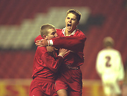 LIVERPOOL, ENGLAND - Tuesday, January 7, 1997: Liverpool's Michael Owen celebrates scoring from the penalty spot Manchester United with team-mate Andy Parkinson during the FA Youth Cup match at Anfield. United won 2-1. (Pic by David Rawcliffe/Propaganda)