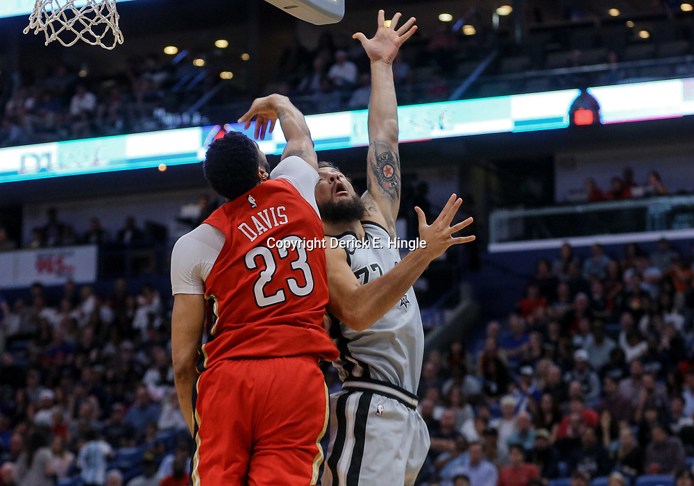 Apr 11, 2018; New Orleans, LA, USA; New Orleans Pelicans forward Anthony Davis (23) blocks a shot by San Antonio Spurs center Joffrey Lauvergne (77) during the second half at the Smoothie King Center. The Pelicans defeated the Spurs 122-98. Mandatory Credit: Derick E. Hingle-USA TODAY Sports