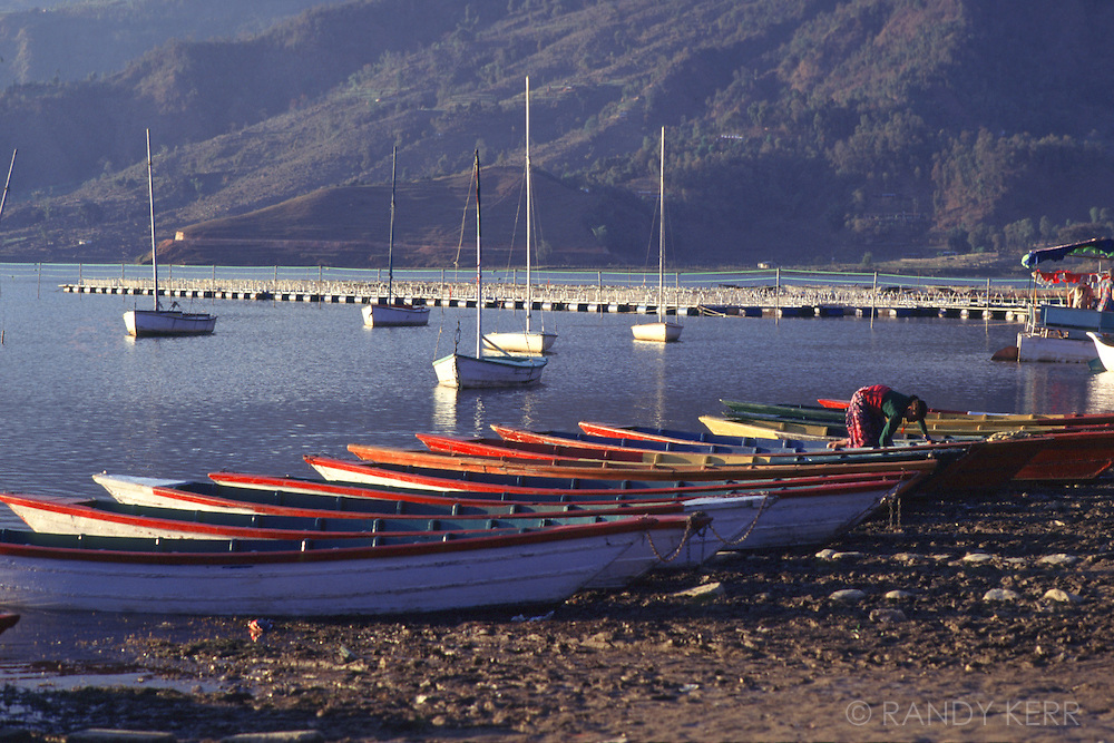 Boats on shoreline in Pokhara, Nepal