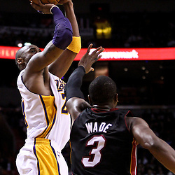 March 10, 2011; Miami, FL, USA; Los Angeles Lakers shooting guard Kobe Bryant (24) shoots over Miami Heat shooting guard Dwyane Wade (3) during the second quarter at the American Airlines Arena.  Mandatory Credit: Derick E. Hingle