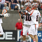Members of the Denver Outlaws celebrate a goal during the game at Harvard Stadium on May 10, 2014 in Boston, Massachusetts. (Photo by Elan Kawesch)