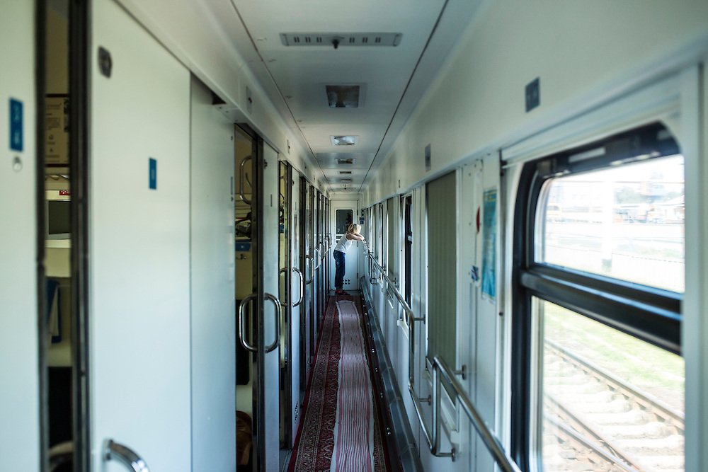 A woman looks out the window of a train arriving in Donetsk on Sunday, July 27, 2014 in Donetsk, Ukraine.