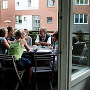 Stockholm, Sweden, August 15, 2012. Tullstugan Collective. Dinner time on the terrace. &quot;It's really nice, after a long day, come to set table and get a good, well-cooked dinner served four nights a week.&quot; says the Tullstugan's website. <br />