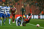 Reading defender Chris Gunter (2)  fouls Middlesbrough midfielder Albert Adomah (27)  during the Sky Bet Championship match between Middlesbrough and Reading at the Riverside Stadium, Middlesbrough, England on 12 April 2016. Photo by Simon Davies.