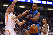 Apr 9, 2017; Phoenix, AZ, USA; Dallas Mavericks guard Yogi Ferrell (11) looses the ball while driving to the basket against Phoenix Suns forward Dragan Bender (35) in the first half of the NBA game at Talking Stick Resort Arena. Mandatory Credit: Jennifer Stewart-USA TODAY Sports