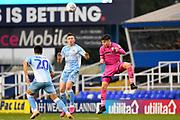 Rochdale midfielder Aaron Morley (28) heads the ball  under pressure from Coventry City midfielder Jordan Shipley (26) during the EFL Sky Bet League 1 match between Coventry City and Rochdale at the Trillion Trophy Stadium, Birmingham, England on 16 November 2019.