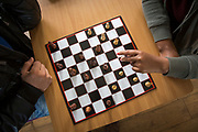 Two unaccompanied minor refugee children play chess together to pass the time in Kent. United Kingdom.  (photo by Andrew Aitchison / In pictures via Getty Images)