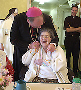 Archbishop Timothy Dolan visits nursing home residents in Milwaukee in 2002. (Sam Lucero photo)