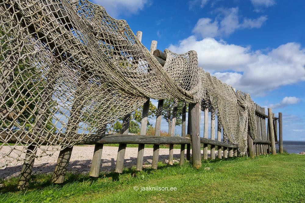 Wooden rural fence draped with netting. Järveveere Holiday Centre in Valma Village on Lake Võrtsjarv in Viljandi County, Estonia.