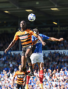 Barnet's Bira Dembélé wins a header in front of Enda Stevens during the Sky Bet League 2 match between Portsmouth and Barnet at Fratton Park, Portsmouth, England on 12 September 2015. Photo by David Charbit.