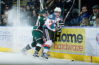 KELOWNA, CANADA - DECEMBER 30: Cody Fowlie #18 of the Kelowna Rockets is checked at the boards by Lucas Grayson #20 of the  Everett Silvertips at the Kelowna Rockets on December 30, 2012 at Prospera Place in Kelowna, British Columbia, Canada (Photo by Marissa Baecker/Shoot the Breeze) *** Local Caption ***