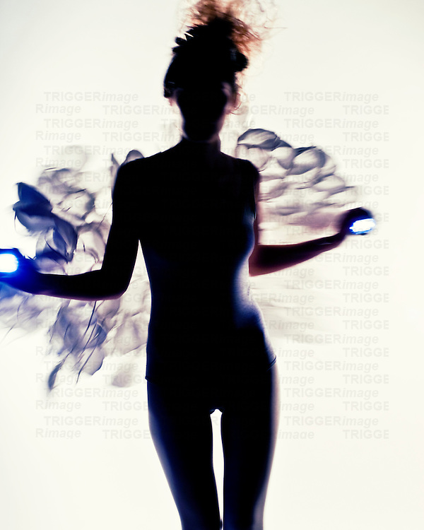A young woman posing in silhouette