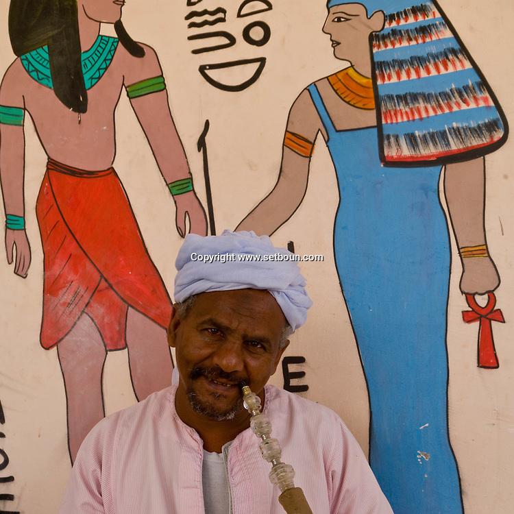 paintings on the walls of GOURNA village in Thebes  alabaster shop  Louxor - Egypte    /  peintures et dessin sur les maison du village de GOURNA a Thebes  fabrique d albatre pour toursites  Louqsor - Egypt
