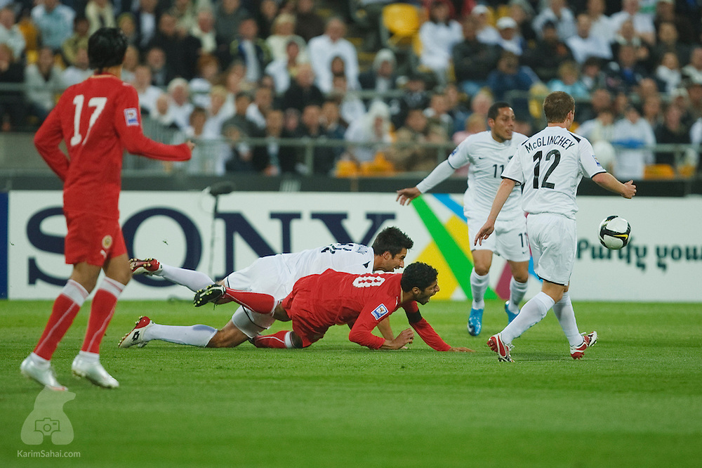 Bahrain captain Mohamed Ahmed Salmeen is tackled by Rory Fallon during the second leg of the 2010 FIFA World Cup qualifying game in front a record 35,194 football fans at Westpac Stadium on November 14, 2009. New Zealand beat Bahrain 1-0 and secured a spot at the 2010 World Cup in South Africa.