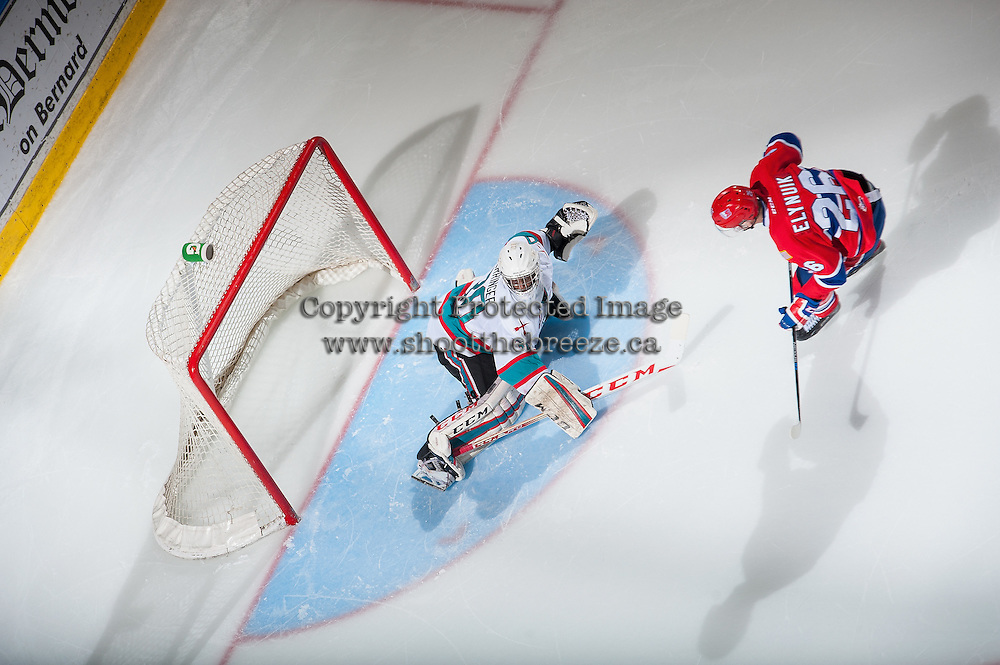 KELOWNA, CANADA - FEBRUARY 27: Michael Herringer #30 of Kelowna Rockets  makes a save during the shoot out on a shot by Hudson Elynuik #26 of Spokane Chiefs on February 27, 2016 at Prospera Place in Kelowna, British Columbia, Canada.  (Photo by Marissa Baecker/Shoot the Breeze)  *** Local Caption *** Michael Herringer; Hudson Elynuik;