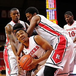 Myles Mack #4 of the Rutgers Scarlet Knights recovers a rebound in a pack during the first half of Rutgers men's basketball vs Temple Owls in American Athletic Conference play on Jan. 1, 2014 at Rutgers Louis Brown Athletic Center in Piscataway, New Jersey.